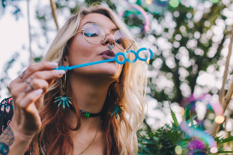 Cannabis Influencers woman blowing bubbles